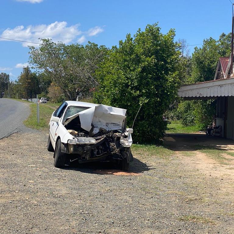 NEAR MISS: A driver has collided with a parked ute in Baree, sending it hurdling into a gazebo manned by election workers.