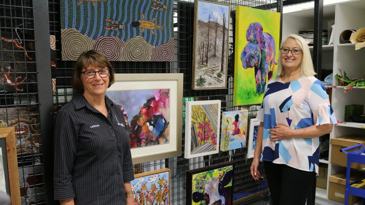 ENJOY ART: Gallery 107 President Carolyn Tillman and Councillor Kaye Maguire inspecting some exhibition submissions