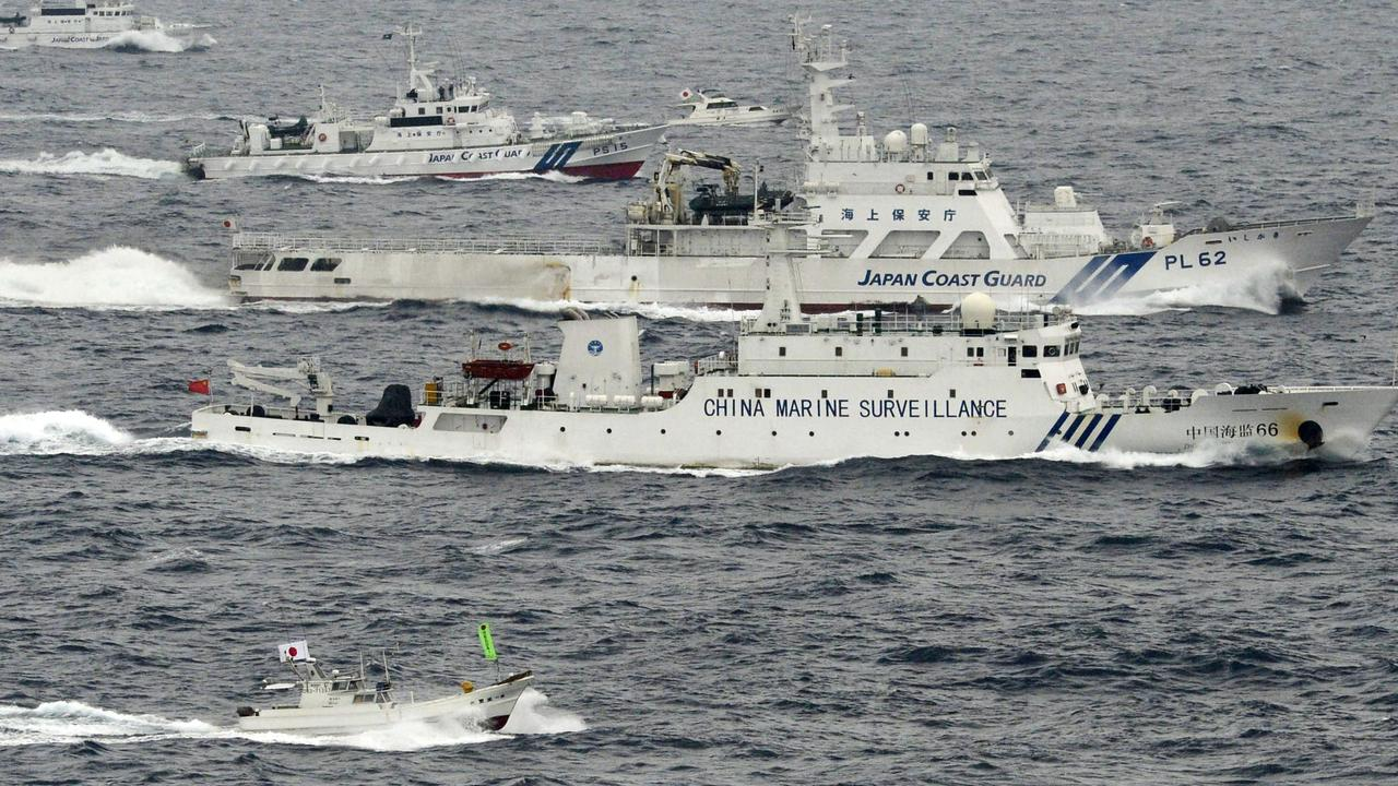 Two Japanese boats and the Japan Coast Guard sail alongside a Chinese surveillance ship near disputed islands in the East China Sea on April 23, 2013. Picture: Kyodo News/AP