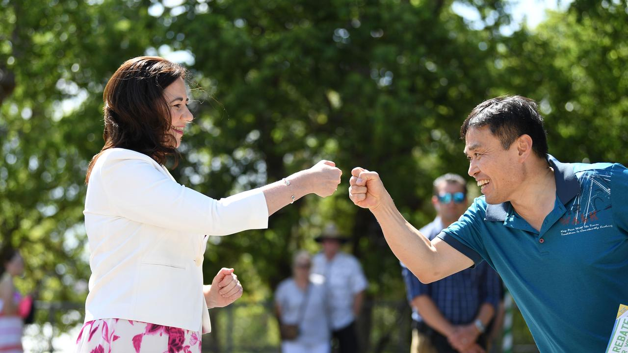 Queensland Premier Annastacia Palaszczuk fist-bump with a voter at a polling booth at Aspley State School on the state Election Day. Picture: NCA NewsWire / Dan Peled