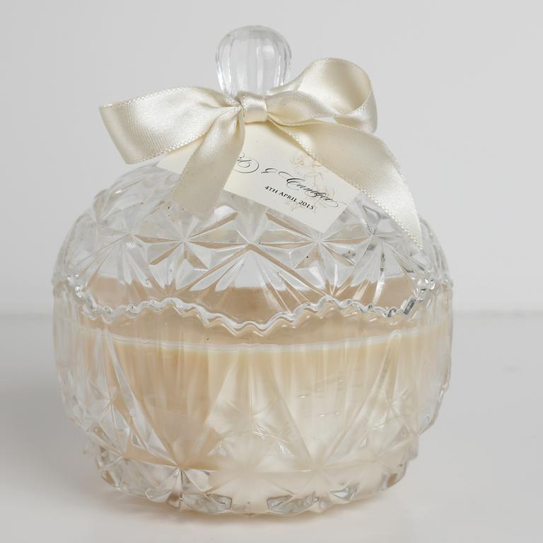 This candle is a wedding favour from Candice and David's special day.