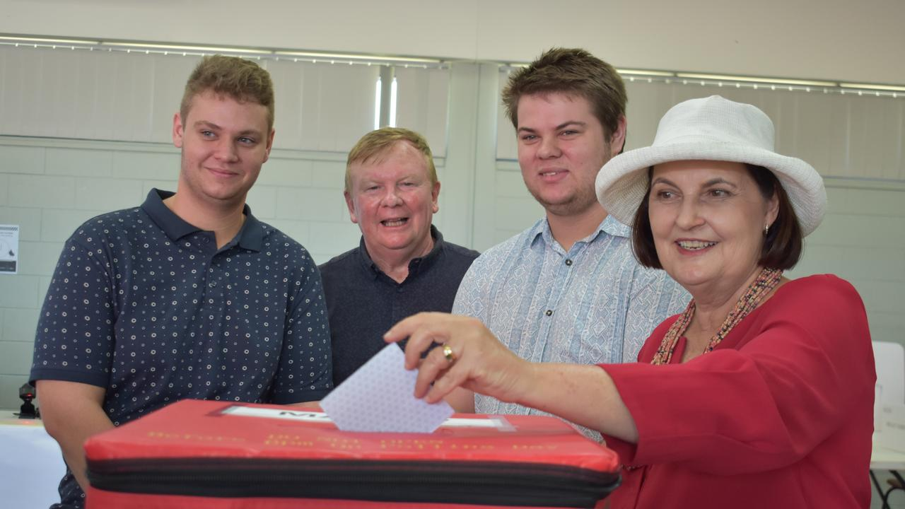 EARLY VOTING: Keione Hulme-Moir, Kai Hulme-Moir and Frank Gilbert watch on as Mackay MP Julieanne Gilbert places her vote in the ballot box at the Mackay Showgrounds early voting centre. Picture: Melanie Whiting