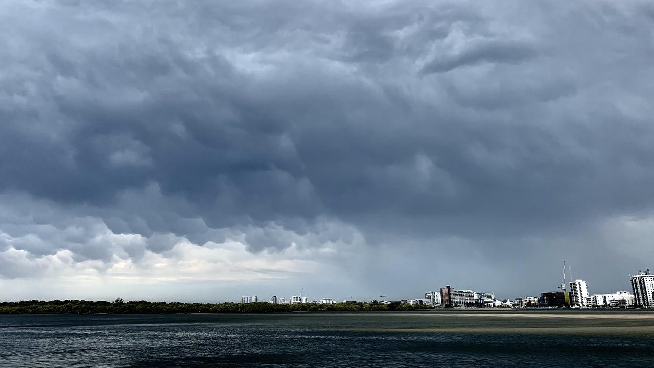 INCOMING: Heavy skies gathering over Maroochydore, looking towards Cotton Tree from the northern side of the Maroochy River, on Saturday.