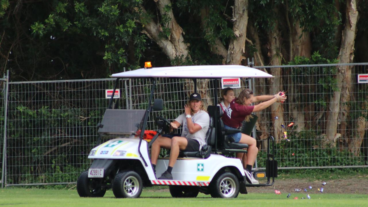 At halftime of the A-grade grand final a golf buggy lapped the field throwing handfuls of lollies to a chasing pack of children. Picture: Tom Threadingham