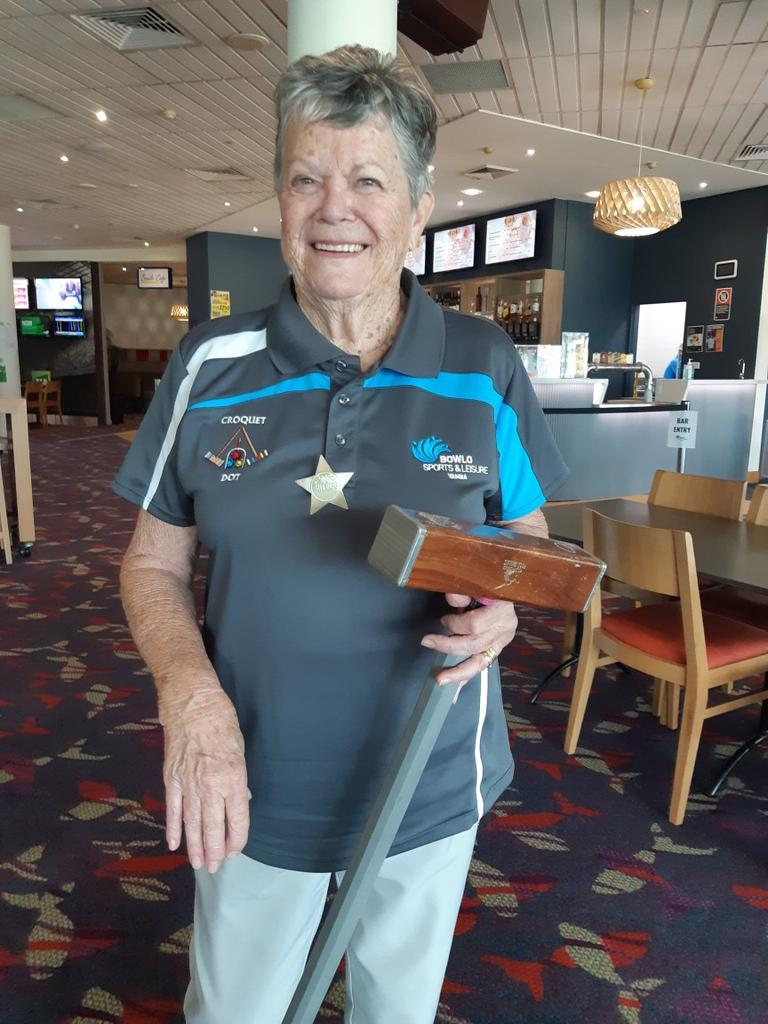 New Yamba Croquet player Dot proudly wearing the Sheriffs badge after running her first hoop