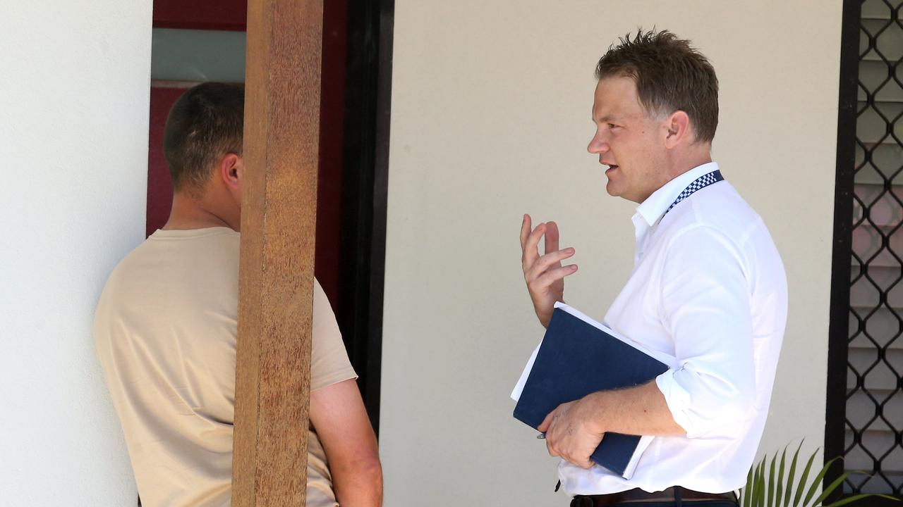 Police speaking to neighbours of a Tingalpa home where a man was allegedly murdered on Saturday night. Picture: Richard Gosling