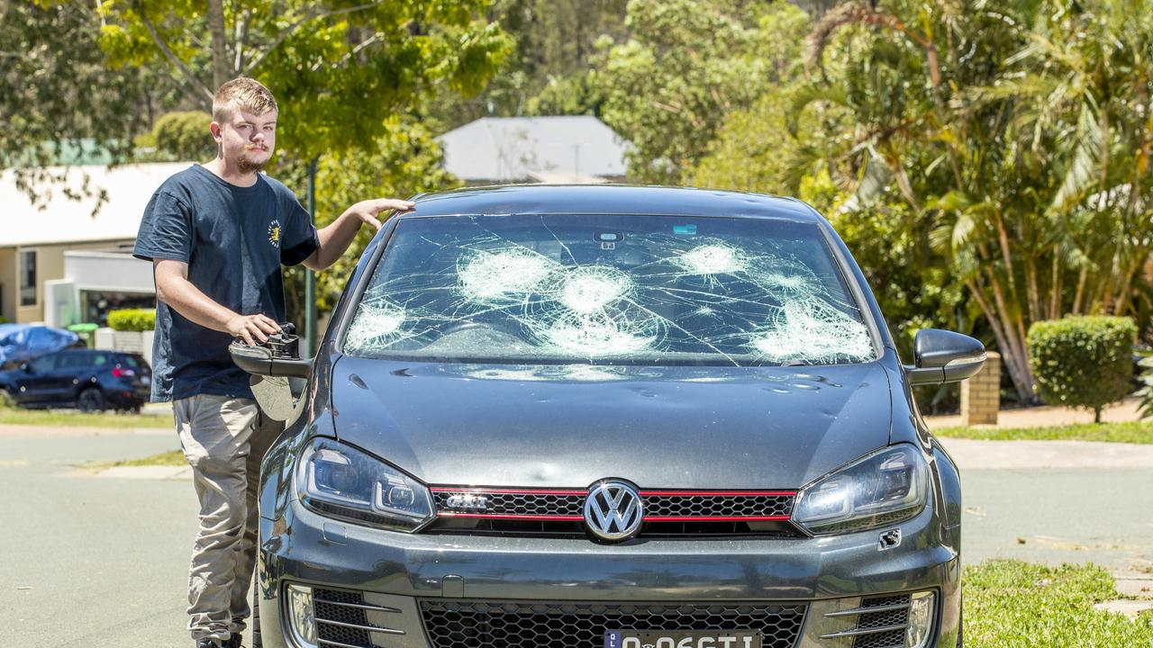 Jaiden Morgan with his storm damaged car at Springfield Lakes. Picture: Richard Walker
