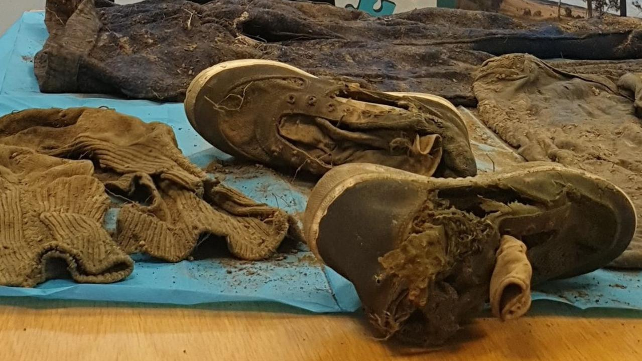 SOMETHING SINISTER? The shoes anbd clothing unearthed suring a search of the area near Keefton Road where a woman's remains were found last month.