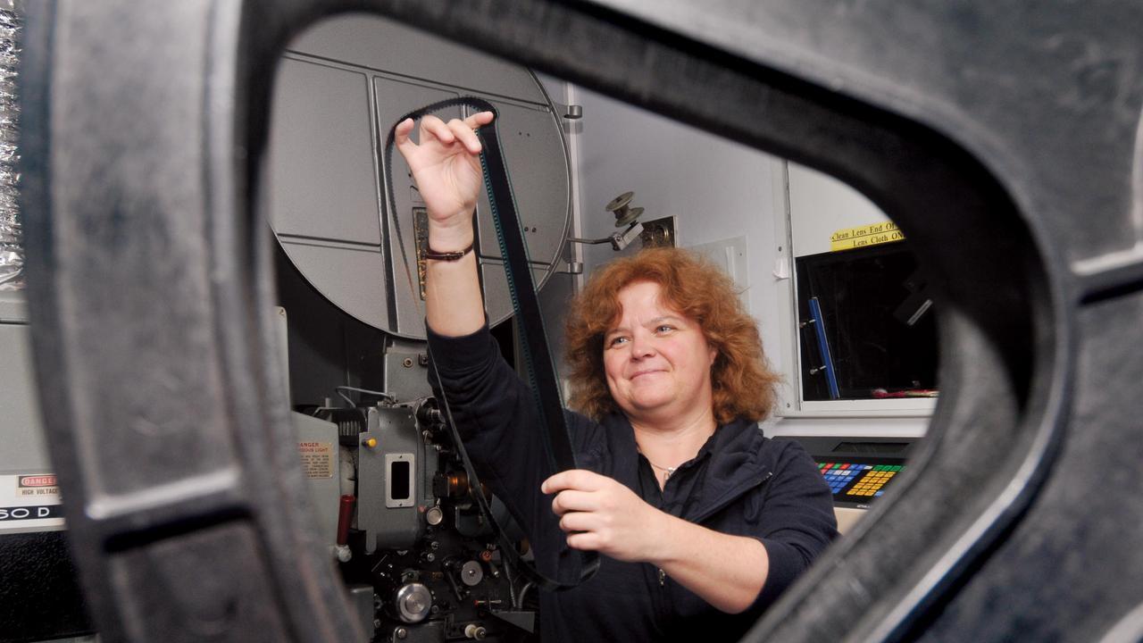 Sally Marsden in the film projection room at Mackay Birch Carroll and Coyle. Photo: Tony Martin / Daily Mercury