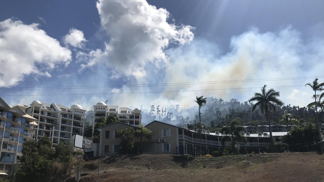 Four fire crews are battling a vegetation fire on Mount Whitsunday Dve. Picture: Elyse Wurm