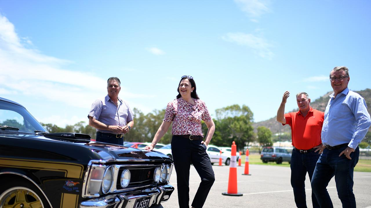Queensland Premier Annastacia Palaszczuk, joined by Thuringowa MP Aaron Harper (left), Labor candidate for Mundingburra Les Walker and Townsville MP Scott Stewart after arriving in a 1969 XW GT Falcon to a regional rally campaign event in Townsville. Queenslanders go to the polls on October 31. Picture: NCA NewsWire / Dan Peled