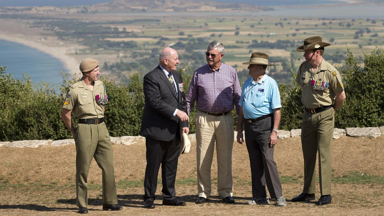 The Honourable Sir Peter Cosgrove (centre left) chats with three of Australia's surviving Victoria Cross recipients and Mr Doug Baird, father of Corporal Cameron Baird VC MG, at the Nek, Gallipoli, Turkey, during the Centenary of the August Offensive commemorative activities on Thursday, 6 August 2015. Left to right: Corporal Mark Donaldson VC; Sir Peter Cosgrove; Mr Doug Baird; Mr Keith Payne VC
