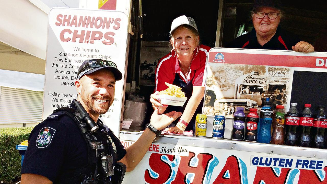 Gympie constable Brent Whittaker visits Shannon's Chips where Gympie local Shirley Woodrow and Michelle Dennes were happy to serve him.