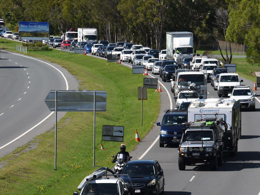"Police are urging motorists to ""pack their patience"" after Queensland border restrictions eased overnight. Picture: NCA NewsWire / Steve Holland"