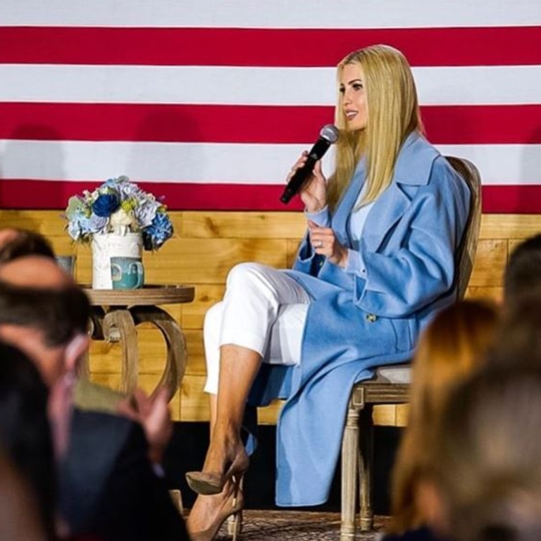 Ivanka in an oversize blue trench coat and capri pants in North Carolina.