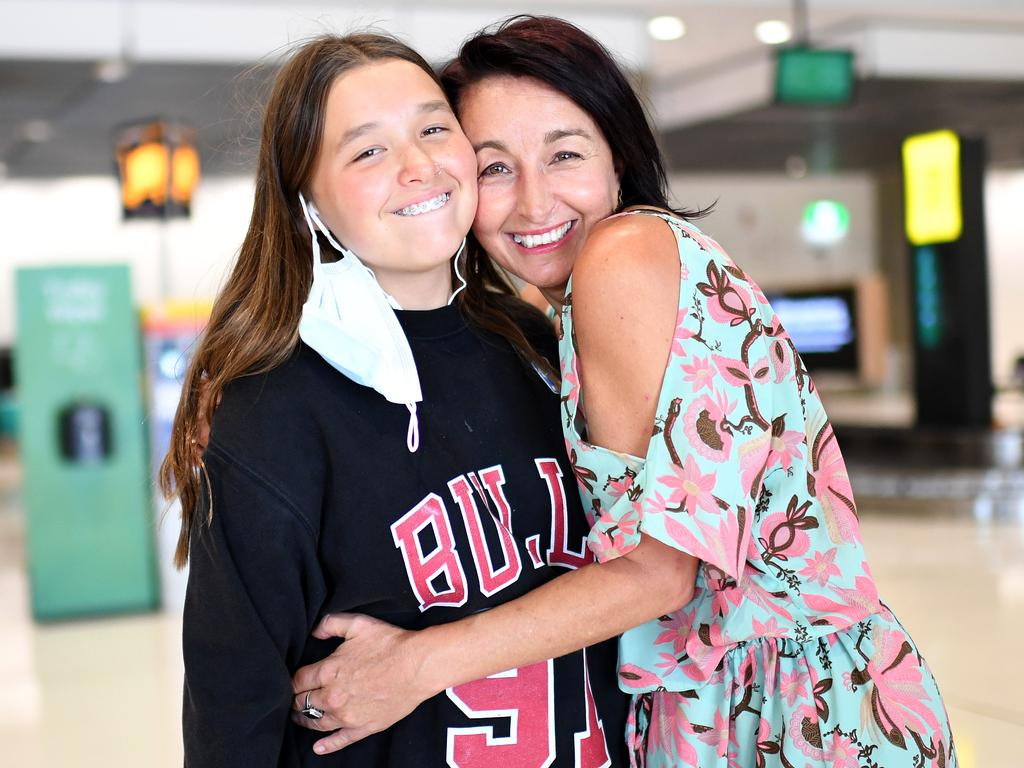 Kym Smith is reunited with daughter Sienna at Brisbane Airport for the first time since March. Picture: Dan Peled/NCA NewsWire