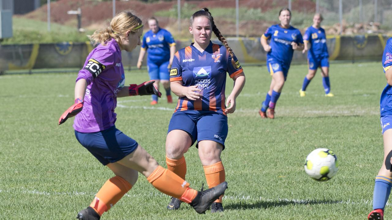 Melony Baker clears the ball for Hawks during a rare stint in goal.