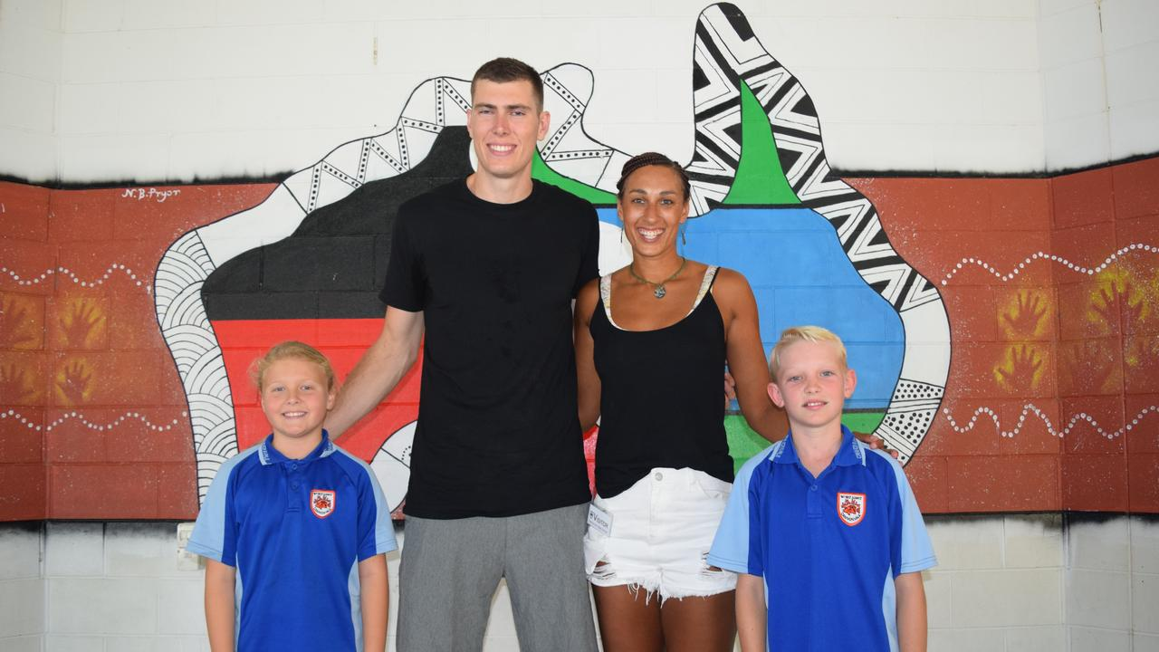 Cannonvale State School Year 4 students Summer Westley (left) and Hudson Price (right) meet Collingwood player Mason Cox and Collingwood Magpies and England Rose netballer Geva Mentor. Photo: Elyse Wurm