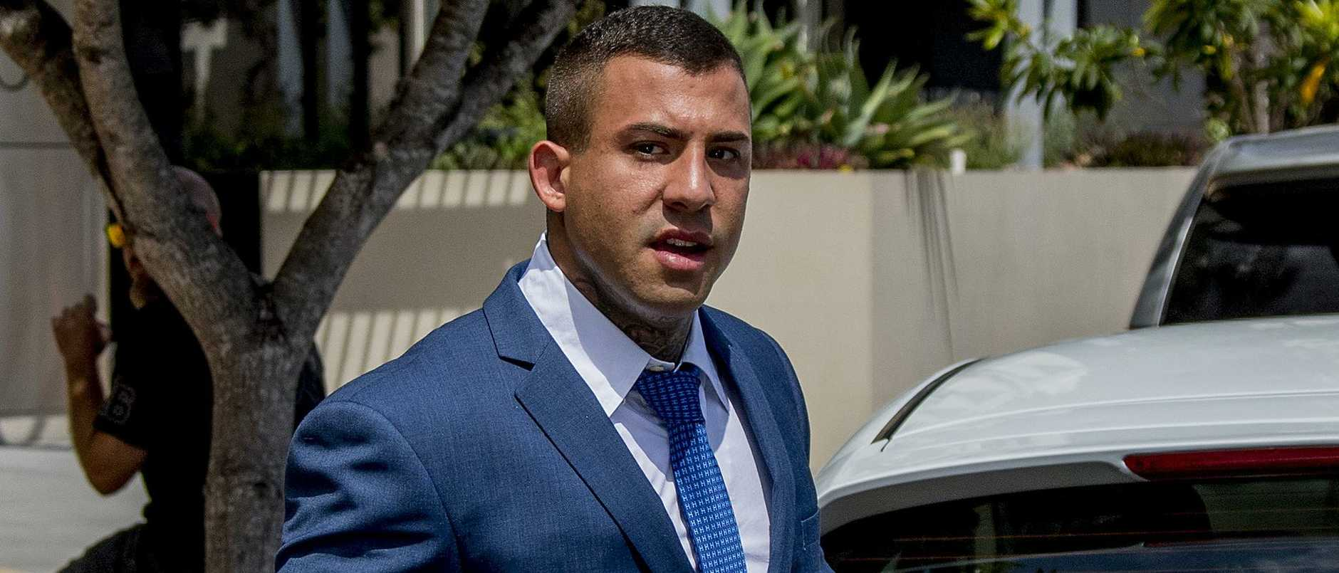 An infamous bikie has been hit with a perjury charge by Crime and Corruption Commission detectives investigating a prominent Gold Coast law firm.