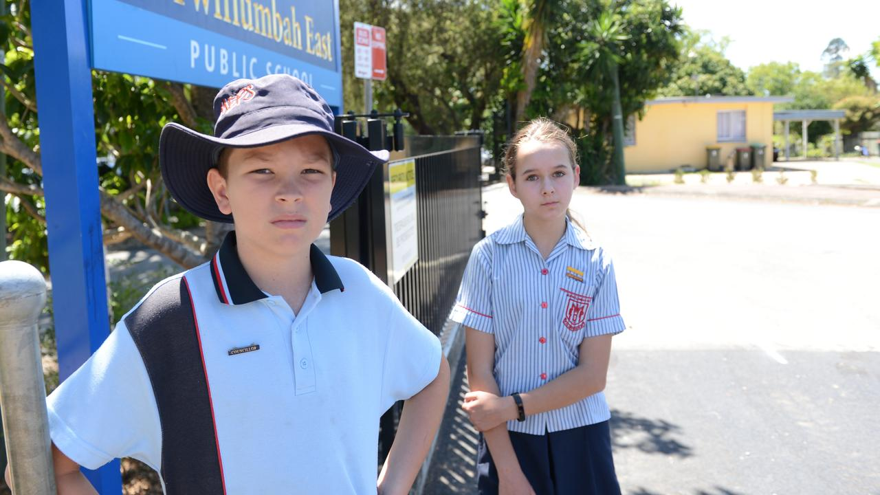 Murwillumbah East Public School students Isaac Rose, Year 6, and Zoe Johnson, Year 5, are unhappy with the state government's plans to merge four schools into one mega-facility. Picture: Liana Boss