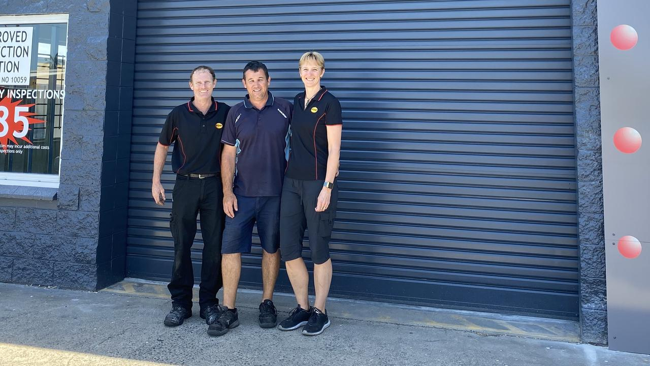 Husband and wife Brendon and Faith Lett have opened their new Midas Mackay store with fellow mechanic Luke Edmunds (centre). Picture: Contributed