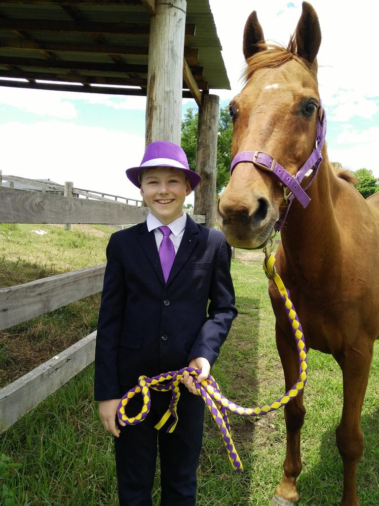 Thomas, 10, wins $50 for 3rd prize in the Grafton Jacaranda Festival's official 2020 Midcoast Family Day Care Best Dressed Boy competition.