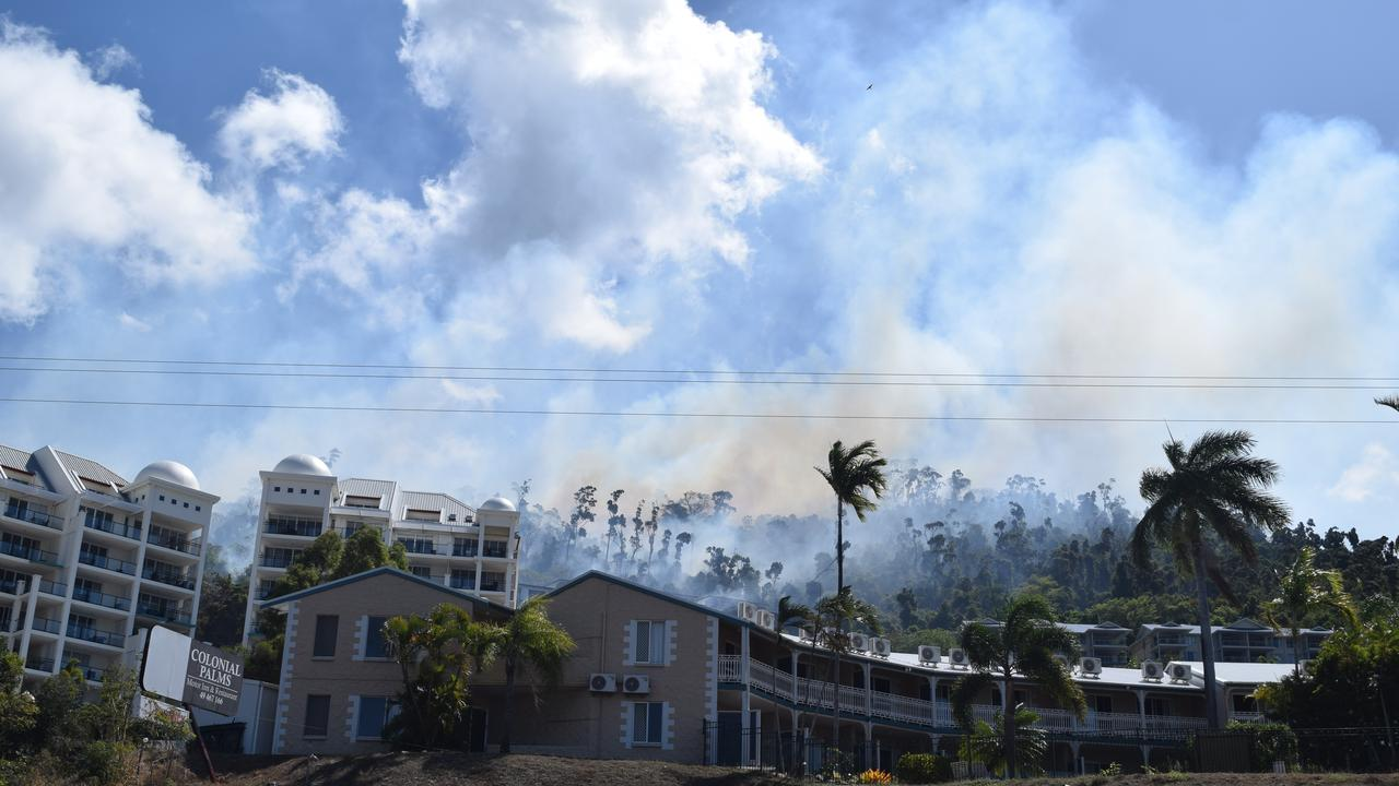 A vegetation fire broke out on Mount Whitsunday Rd in Airlie Beach on Monday. Picture: Elyse Wurm
