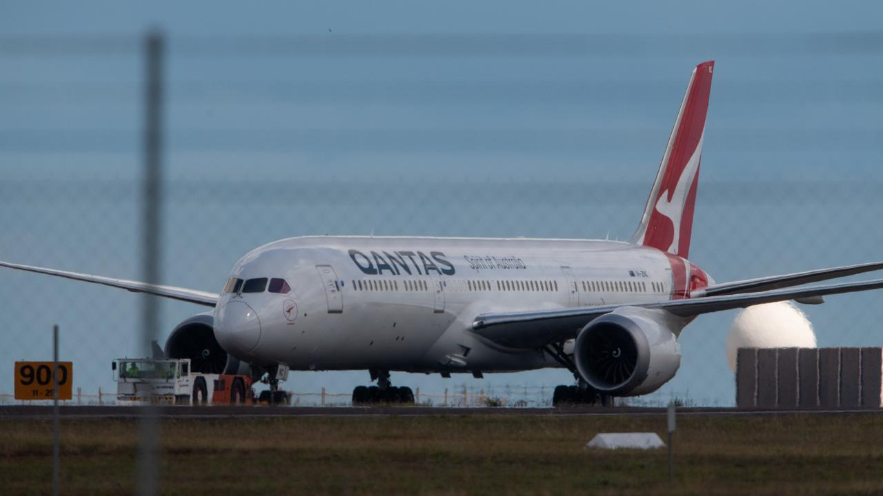 Qantas flight QF112, carrying stranded Aussies from India, lands in Darwin last week. Picture: Che Chorley