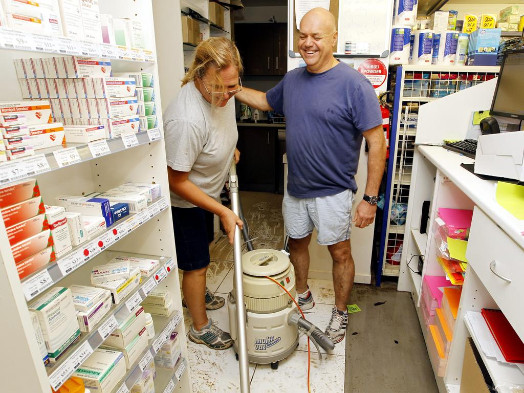 2012 flashback: Glennis and Themi Vanieris at their pharmacy on Alexandra Pde in Maroochydore after flash flooding hit the area. Picture: File.