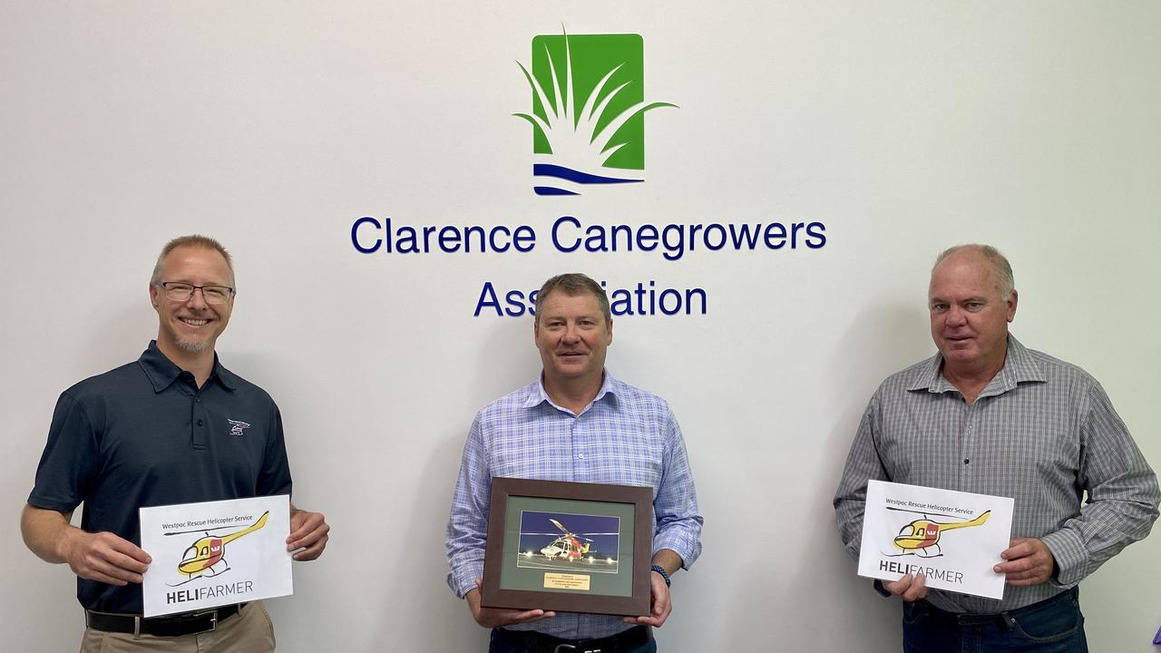 Westpac Rescue Helicopter's Zeke Huish, Clarence Canegrowers Association manager Brendan Reeves and Clarence Canegrowers Association and NSW Canegrowers chairman Ross Farlow.