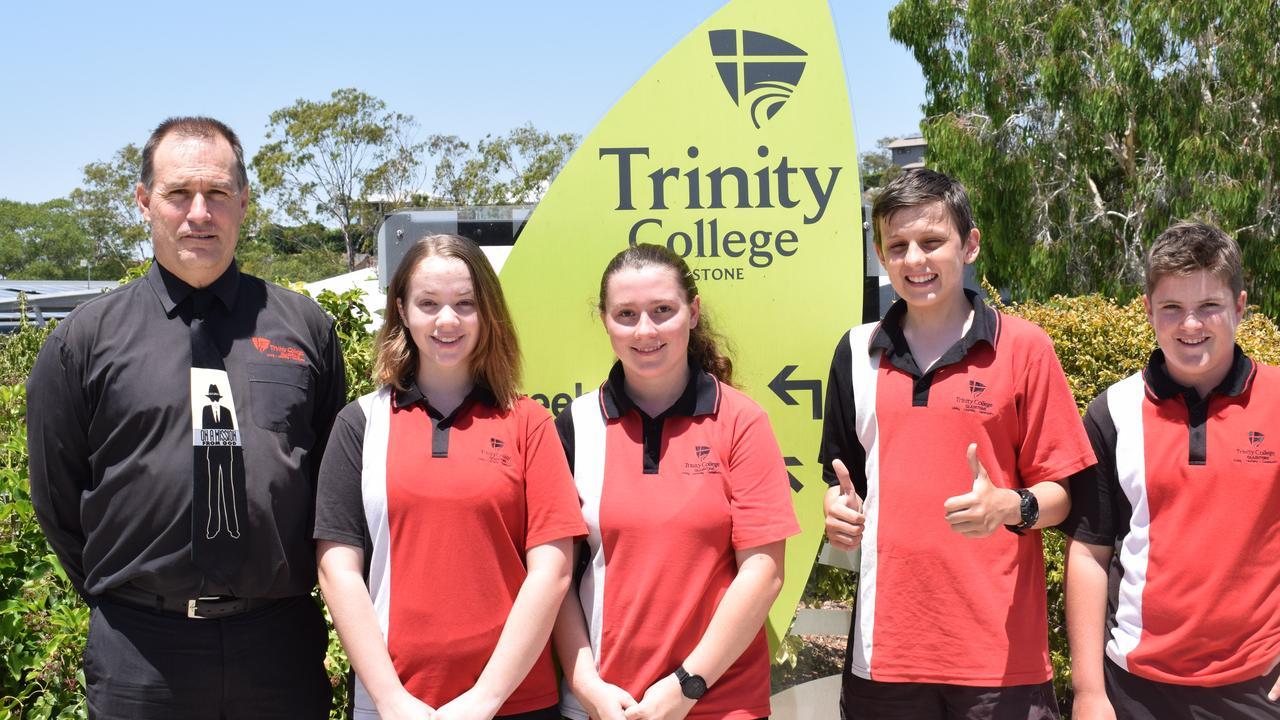 L-R Trinity College Principal Stephen Babbage, Cloe Putland (15), Taylah Ferguson (15), Sebastian Hurcom (15), and James Walden (14).