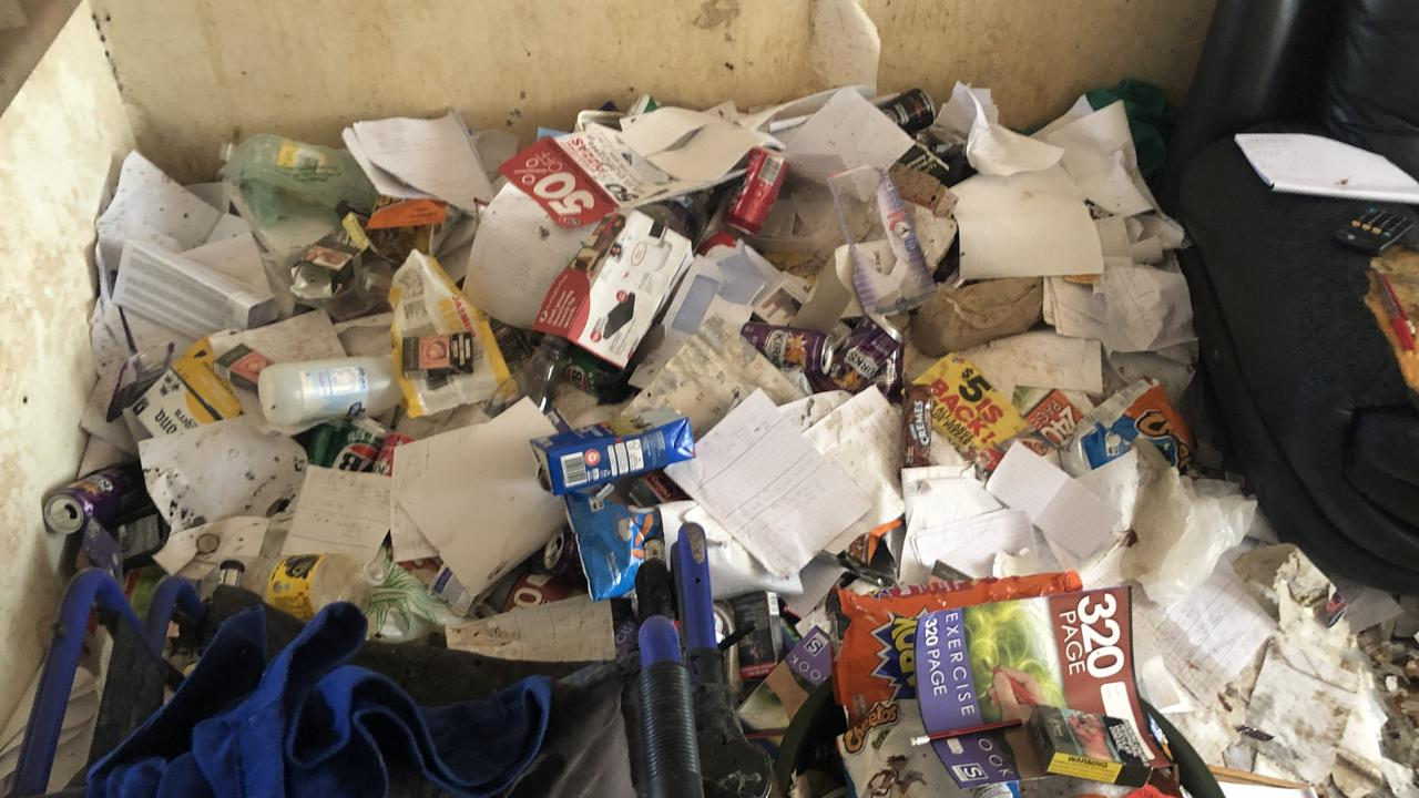 Rubbish next to a couch in a Gold Coast unit's living room. Photo: BIO Busters