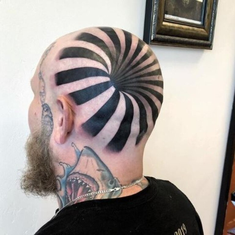 Last month, a tattoo artist shared a photo of the optical illusion work he did for his friend, which makes it looks like there is a massive hole in his head. Picture: Jam Press