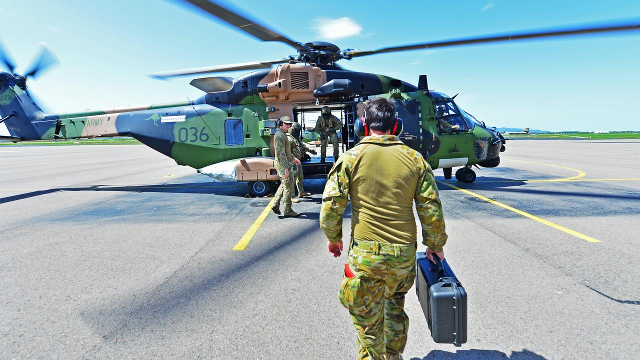 Members from 5th Aviation Regiment get on board a MRH-90 Taipan\. Picture: Zak Simmonds