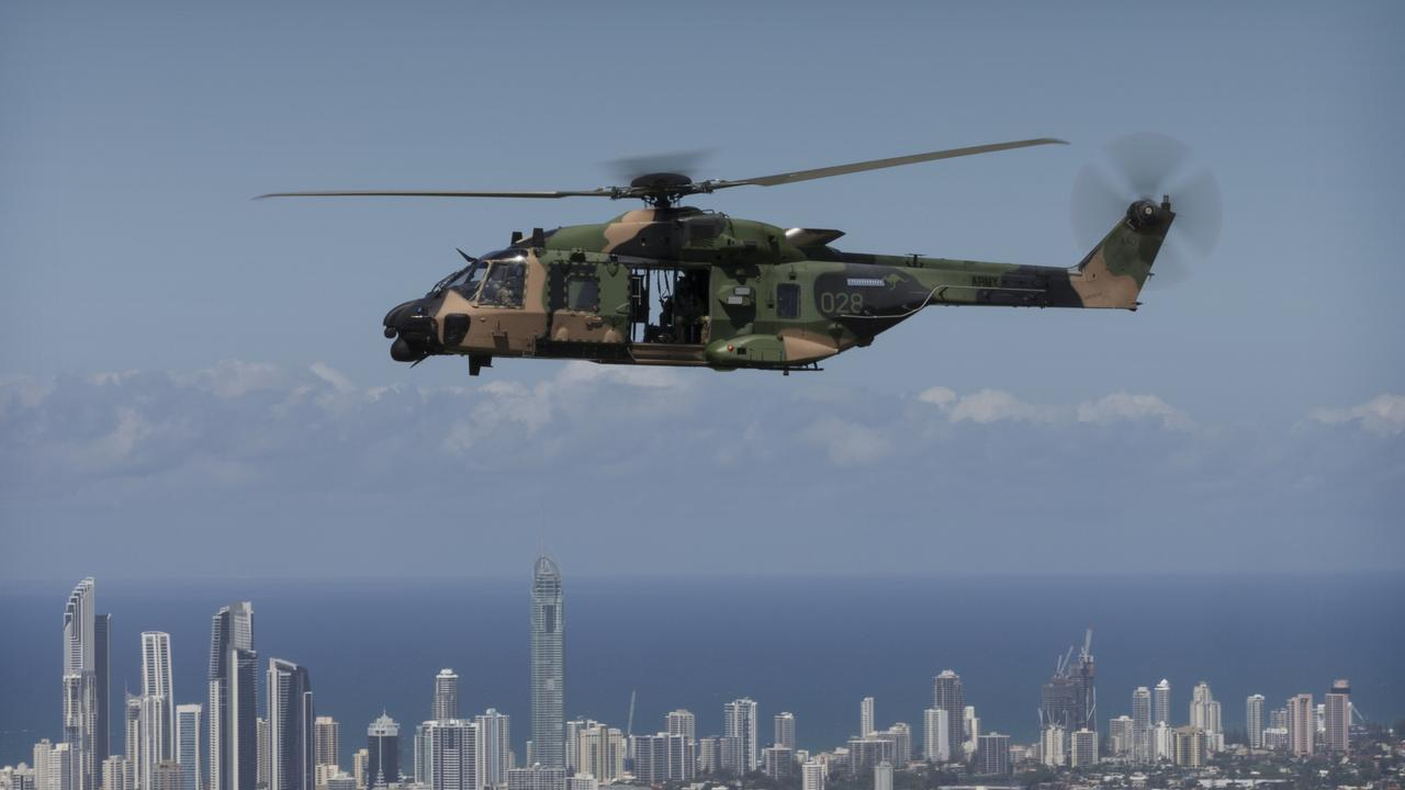 An Australian Army Multi Role Helicopteraircraft flies the Queensland Police Service Special Emergency Response Team over the Gold Coast as part of familiarisation training for the 2018 Commonwealth Games.