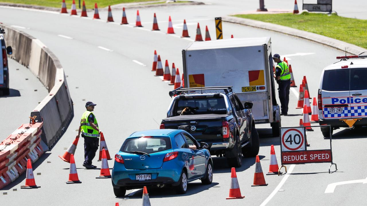 Police at the Queensland border on the Gold Coast Highway. Picture: Nigel Hallett