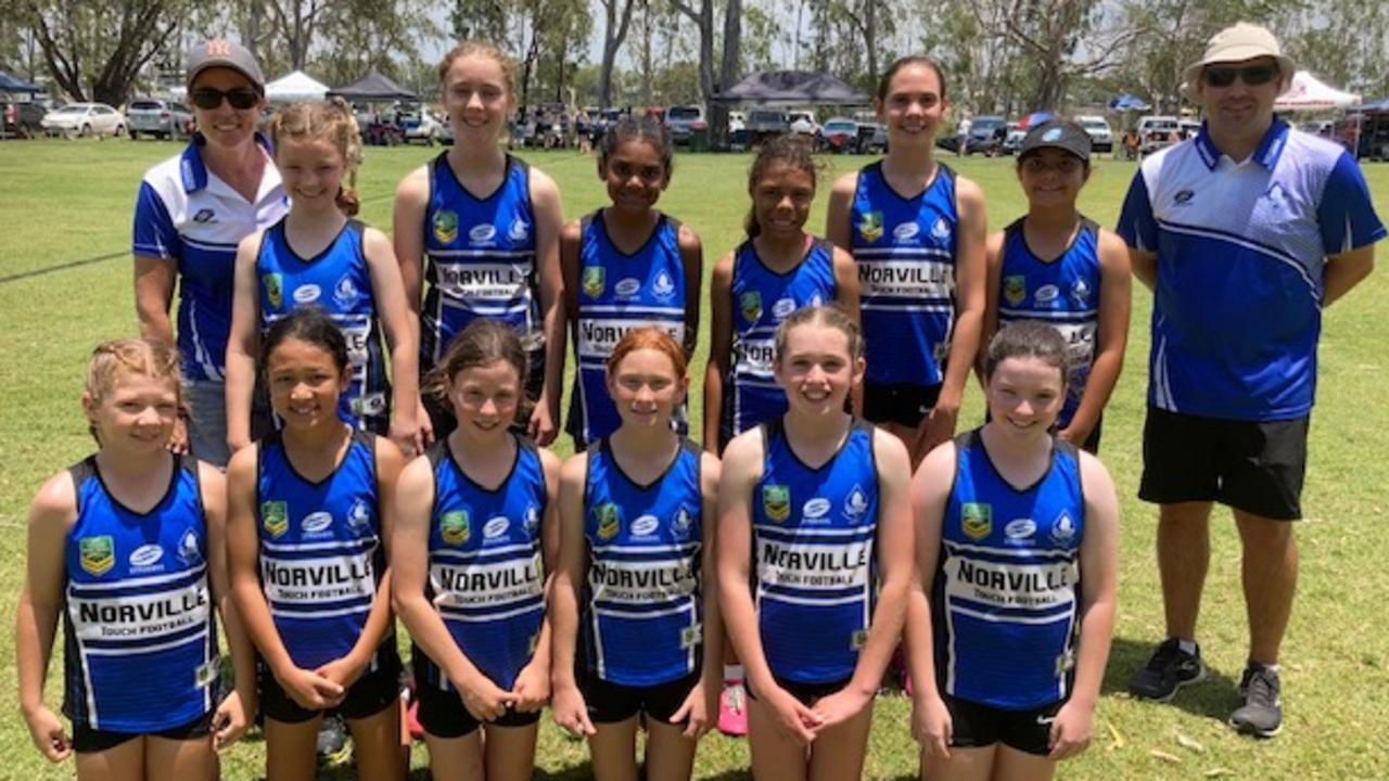 Coach Adam Lovett and the Norville State School team that is competing for the first time at the Red Rooster Junior Carnival in Rockhampton.