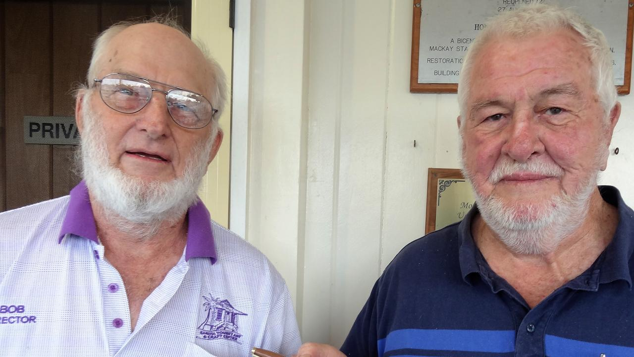 Sarina Arts and Crafts Centre board chairman Bob Neilsen with retiring board member Rod Nunn at the group's annual general meeting. Picture: Contributed