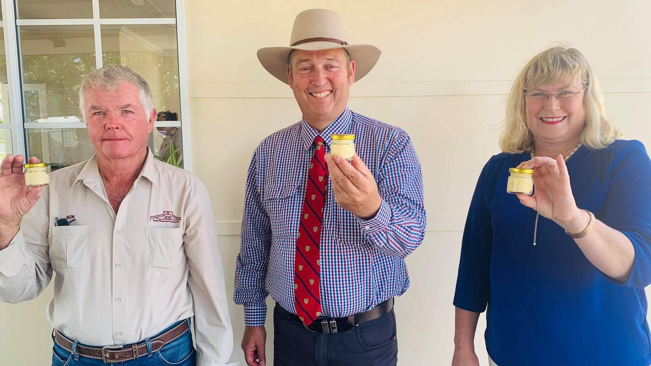 President of the Roma Historical Precincts Incorporation, Ken Beitz, Maranoa Regional Council Mayor Tyson Golder and Warrego MP Ann Leahy showing off the butter they made.