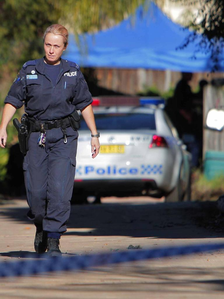 Police at the scene of the Lin family murders in North Epping.