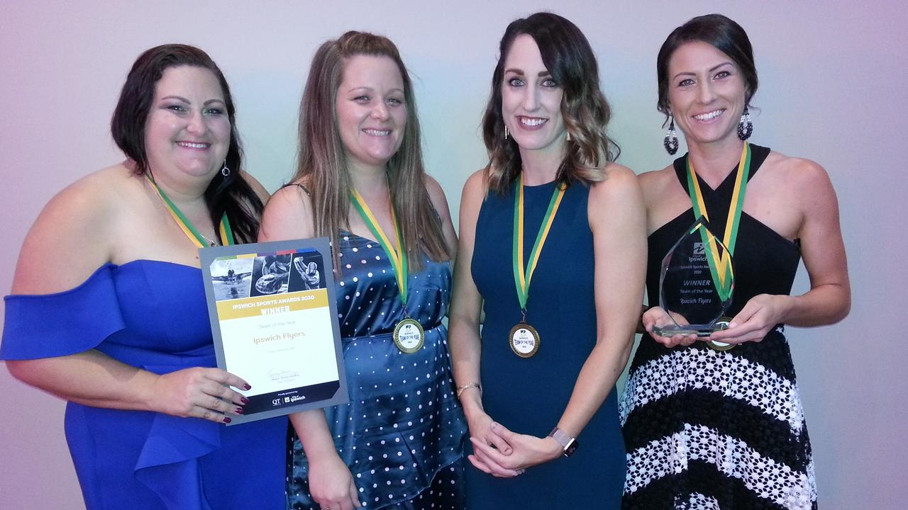 Ipswich Flyers representatives Mel de Kleyn (manager), Emilie McInally (captain), Nicole Grant (coach) and player Skye Sippel celebrate the team's success. The Flyers were named Team of the Year at the 2020 Ipswich Sports Awards. Picture: David Lems