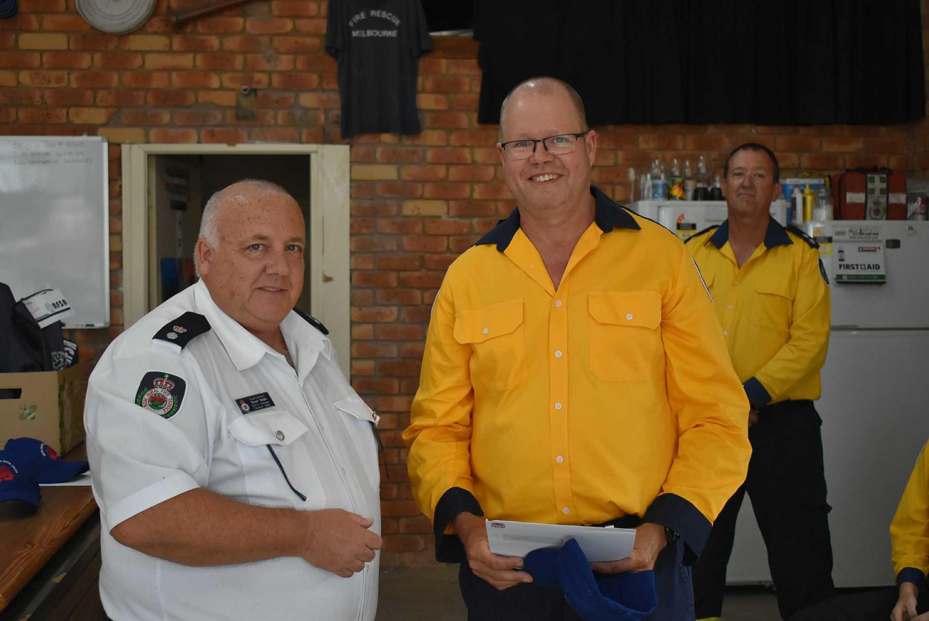 Lawrence RFS deputy captain Paul Simpson receiving a citation award for his work during the 2019-20 bushfire season.