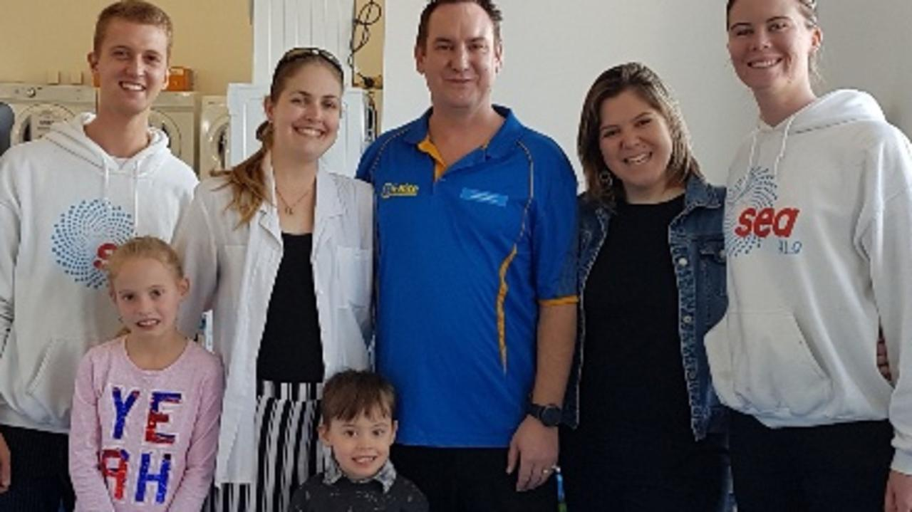 OPENING IN GYMPIE: Sunshine Coast Washers and Fridges Lea-Anne Buck (second left), John Buck (centre), their children Jane and Patrick with the Sea FM Crew..