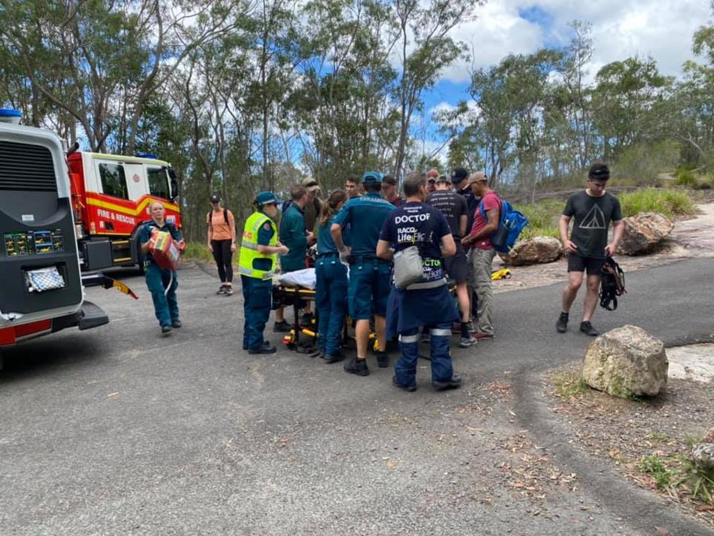 A pair of rock climbers had to be helped off a mountain, one by a stretcher, and taken to hospital after they fell about 15m off a cliff face. Photo: WIN News Sunshine Coast
