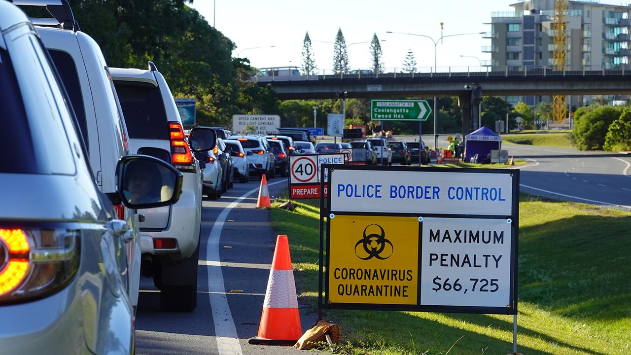 Line up of cars at the Queensland border.