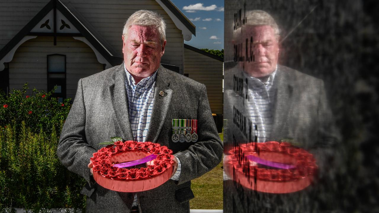 Maclean RSL Sub-Branch president Steve Walton with a wreath at the scaled-back Remembrance Day ceremony in Maclean. Photo: Adam Hourigan