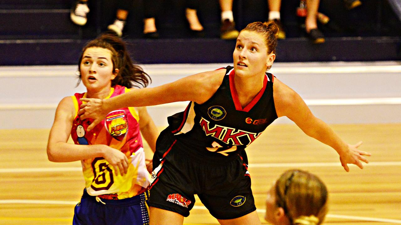 QBL women's match between the Townsville Flames v Mackay Meteorettes from Murray Basketball Stadium. Meteorettes' Kayla Standish (now Steindl) and Flames' Caitlyn Biondi-Howarth. Picture: Zak Simmonds