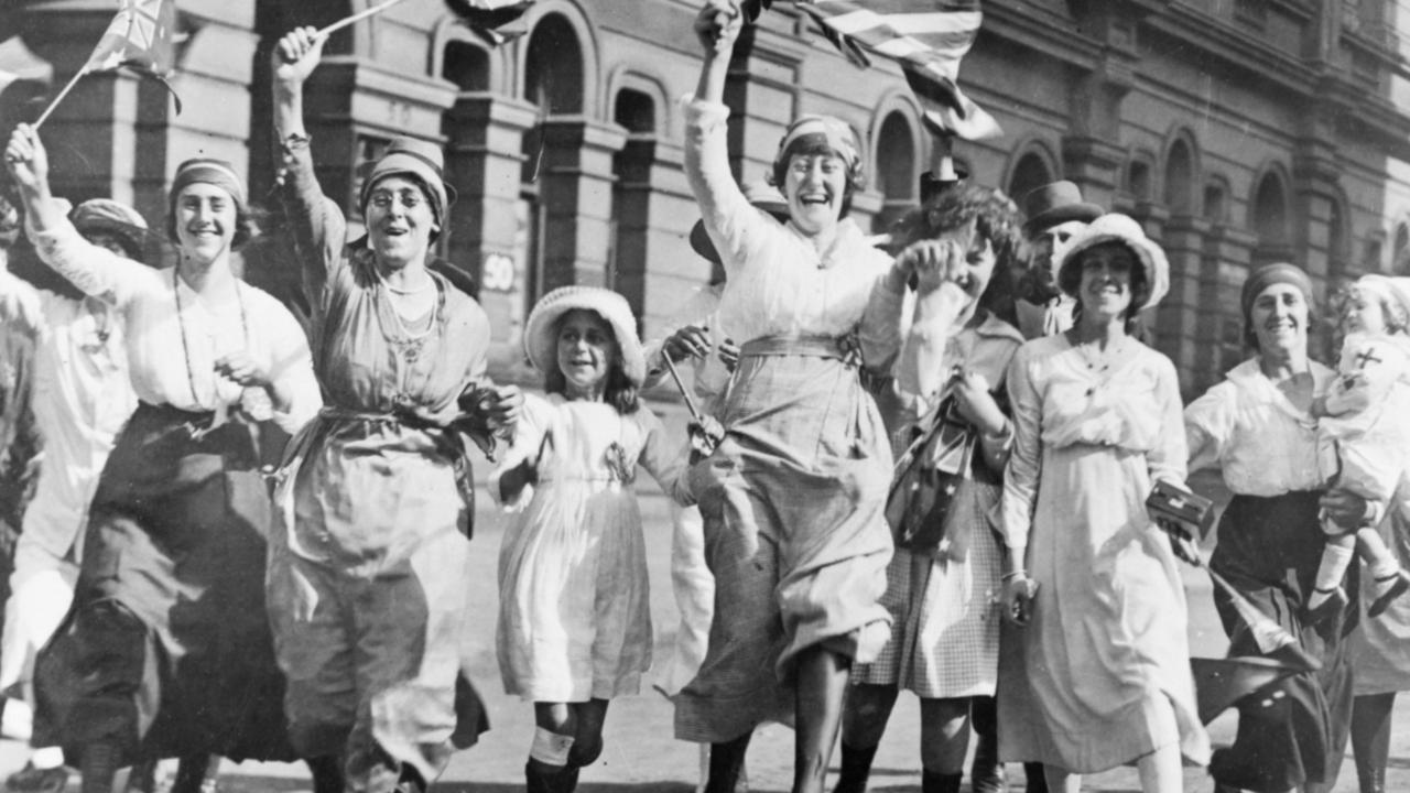 A group of women and children rejoicing in the street at the signing of the Armistice. Picture: Australian War Memorial Remembrance Day