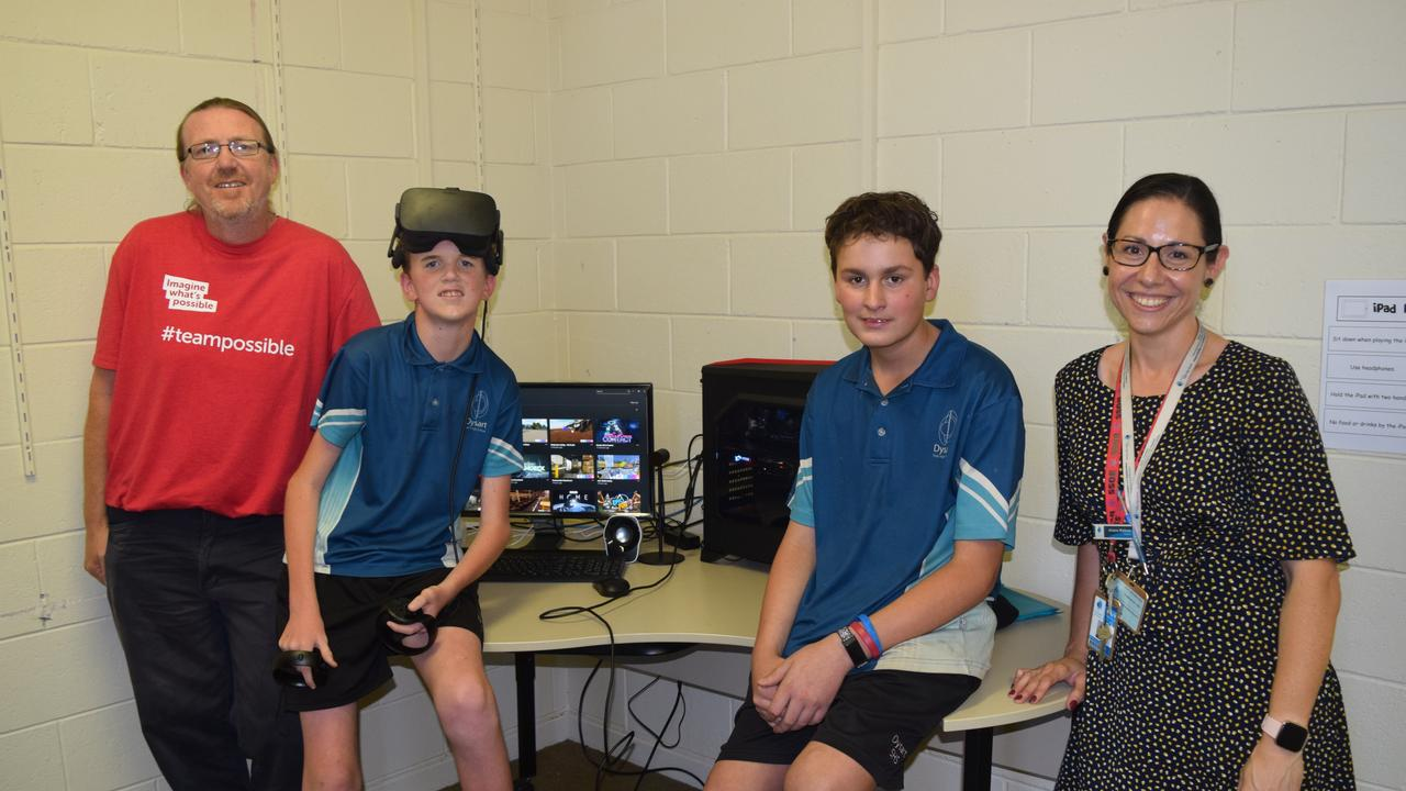 Endeavour Foundation Service Designer Chris Beaumont and DSHS students with disabilities support teacher Ariana Walkom with Year 8 students Jayden Lumsdale and Jacob Nitschke.