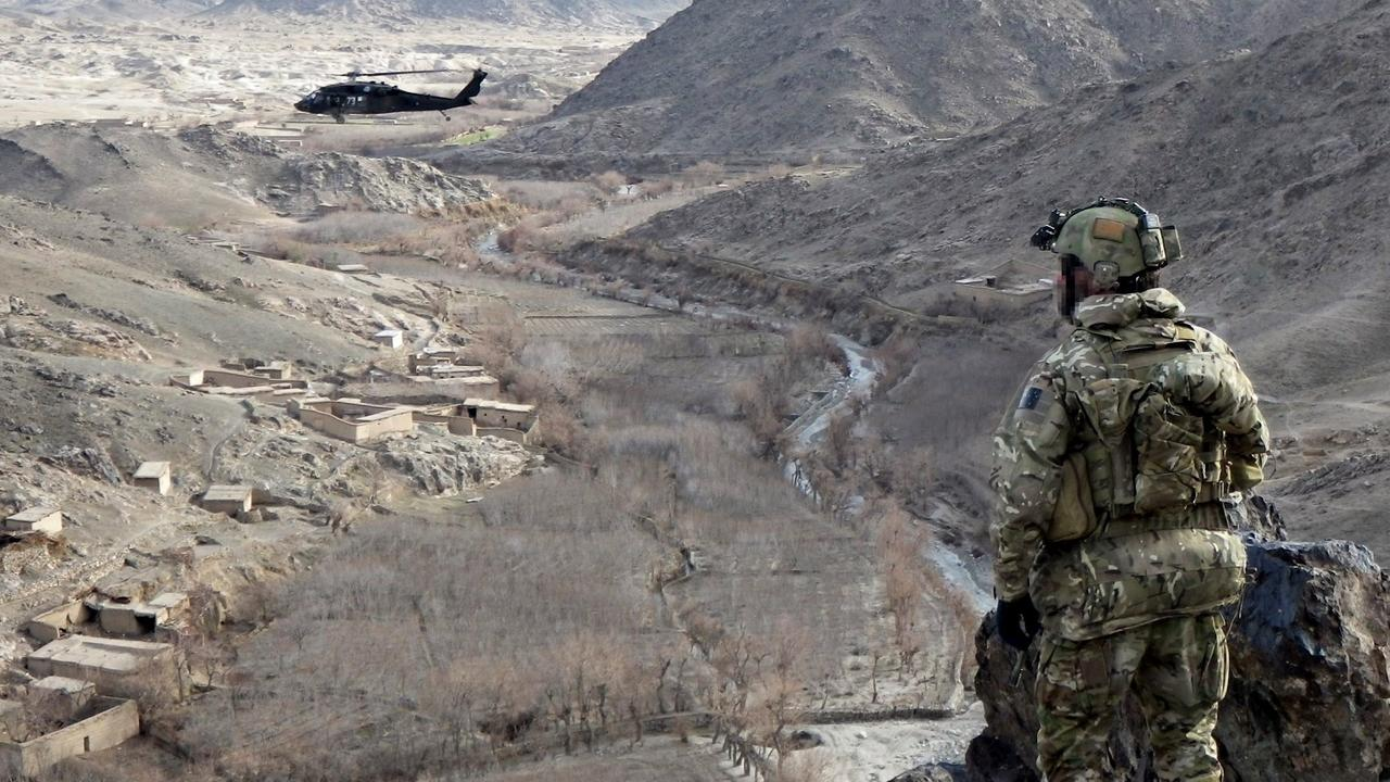 An Australian soldier from Special Operations Task Group keeps watch over a village in Uruzgan province.